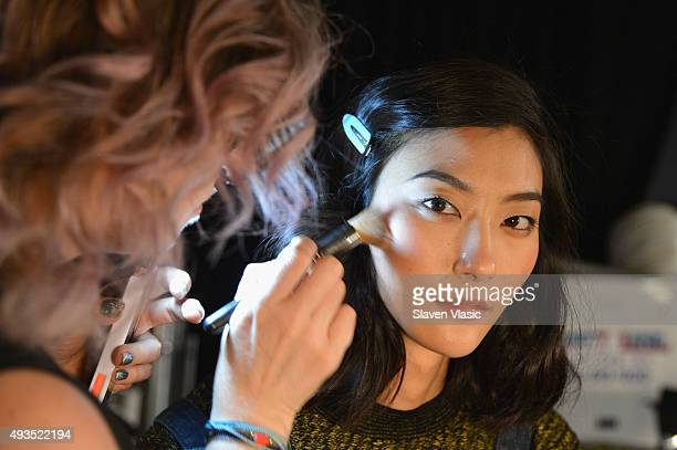A model prepares backstage at the BALMAIN X HM Collection Launch at 23 Wall Street on October 20 2015 in New York City
