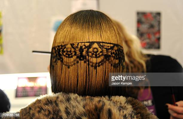 A model prepares backstage at the Betsey Johnson Fall 2011 fashion show during MercedesBenz Fashion Week at The Theatre at Lincoln Center on February...