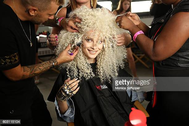 A model prepares backstage at The Blonds fashion show during MADE Fashion Week September 2016 at Milk Studios on September 11 2016 in New York City
