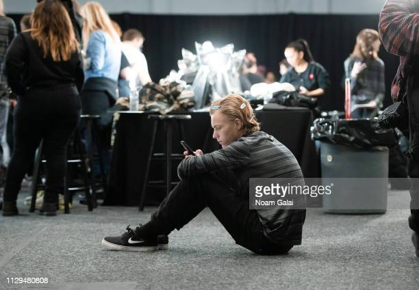 A model prepares backstage at the BOSS Womenswear Menswear fashion show during New York Fashion Week on February 13 2019 in New York City