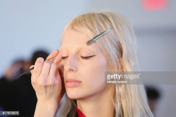 A model prepares backstage at the Calvin Luo fashion show during New York Fashion Week on February 13 2018 in New York City