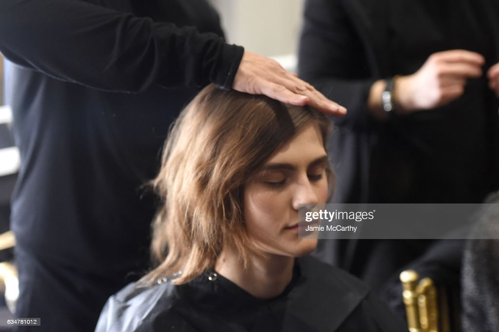 A model prepares backstage at the Christian Siriano show during, New York Fashion Week: The Shows at The Plaza Hotel on February 11, 2017 in New York City.