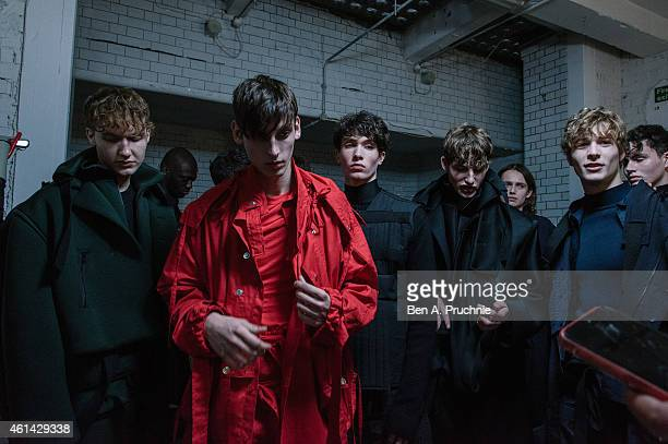 A model prepares backstage at the Craig Green show at the London Collections Men AW15 at Victoria House on January 12 2015 in London England