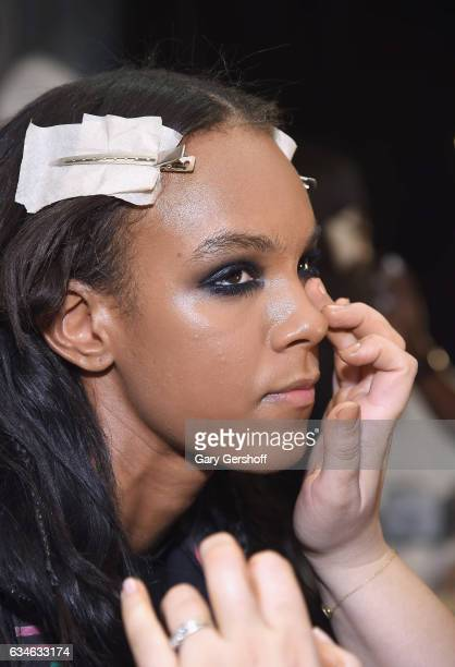 A model prepares backstage at the Cushnie Et Ochs fashion show during February 2017 New York Fashion Week at Gallery 1 Skylight Clarkson Sq on...
