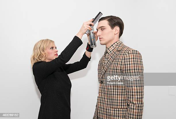 A model prepares backstage at the Darkoh fashion show during MercedesBenz Fashion Week Fall 2015 at The Designer's Loft on February 12 2015 in New...