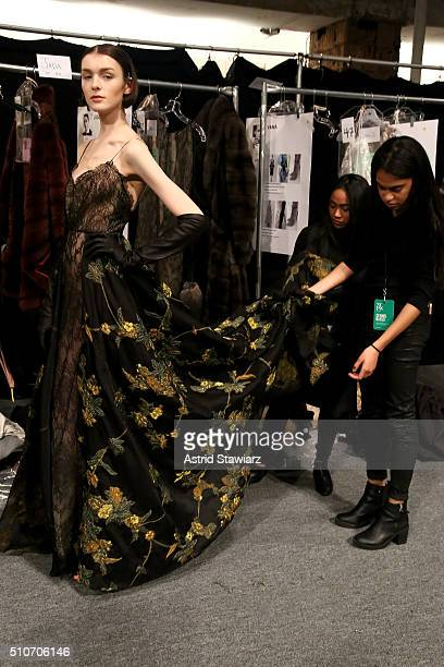 A model prepares backstage at the Dennis Basso Fall 2016 fashion show during New York Fashion Week The Shows at The Arc Skylight at Moynihan Station...