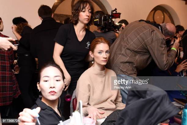 Model prepares backstage at the Dennis Basso Fall/Winter 2018 Collection Runway Show at Saint Bart's Church on February 12 2018 in New York City