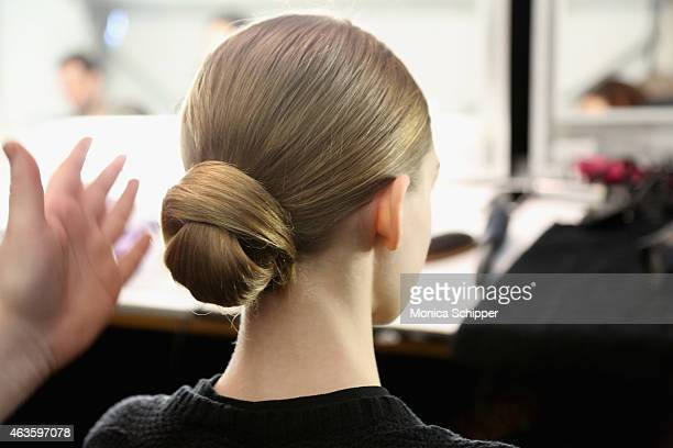 A model prepares backstage at the Dennis Basso fashion show during MercedesBenz Fashion Week Fall 2015 at The Theatre at Lincoln Center on February...
