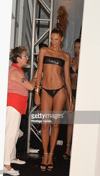 A model prepares backstage at the Dolores Cortes show during MercedesBenz Fashion Week Swim 2015 at Cabana Grande at The Raleigh on July 18 2014 in...