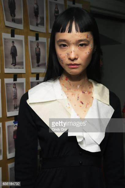 A model prepares backstage at the Eckhaus Latta fashion show during New York Fashion Week on February 13 2017 in New York City