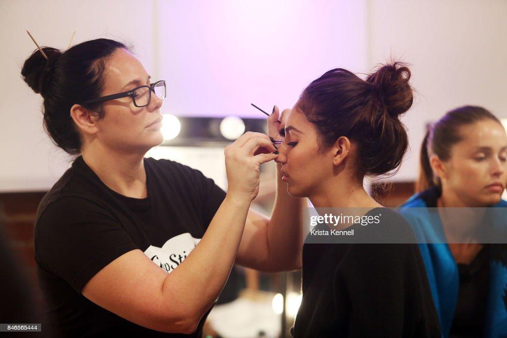 A model prepares backstage at the Eva Longoria Collection at Metropolitan Pavilion on September 13, 2017 in New York City.