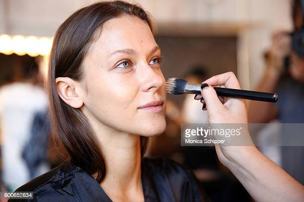 A model prepares backstage at the Fashion Palette Australian Swim/Resort fashion show during New York Fashion Week September 2016 at Pier 59 Studios...