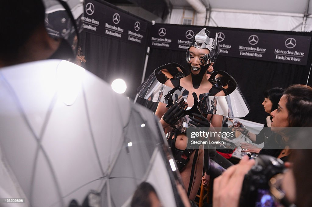 A model prepares backstage at the FTL Moda fashion show during Mercedes-Benz Fashion Week Fall 2015 at The Salon at Lincoln Center on February 15, 2015 in New York City.