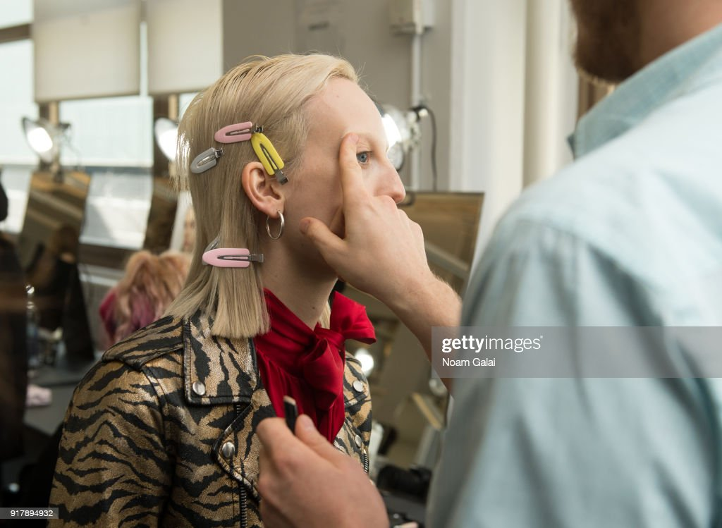 A model prepares backstage at the Gabriela Hearst fashion show during New York Fashion Wee on February 13, 2018 in New York City.