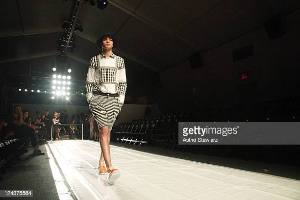 A model prepares backstage at the General Idea Spring 2012 fashion show during MercedesBenz Fashion Week at The Studio at Lincoln Center on September...