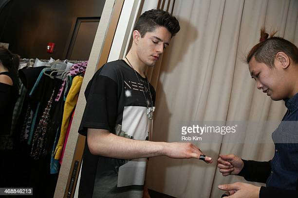 A model prepares backstage at the Geoffrey Mac For Sharon Needles Show during MercedesBenz Fashion Week Fall 2014 at The Out NYC on February 11 2014...