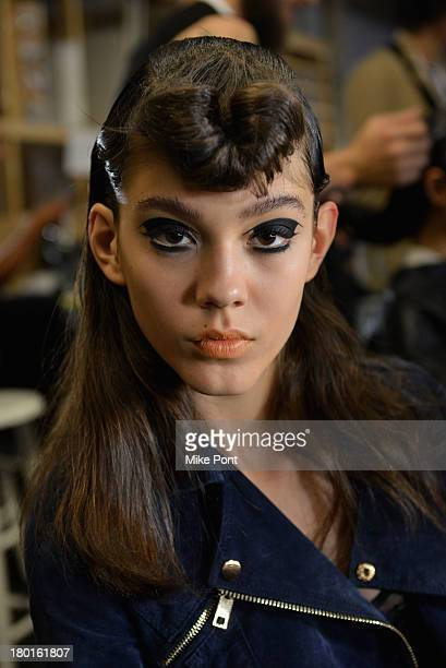 A model prepares backstage at the Hache presentation during MercedesBenz Fashion Week Spring 2014 at Hosfelt Gallery on September 9 2013 in New York...