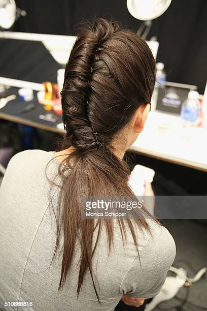 A model prepares backstage at the Hiromi Asai Fall 2016 fashion show during New York Fashion Week The Shows at The Dock Skylight at Moynihan Station...