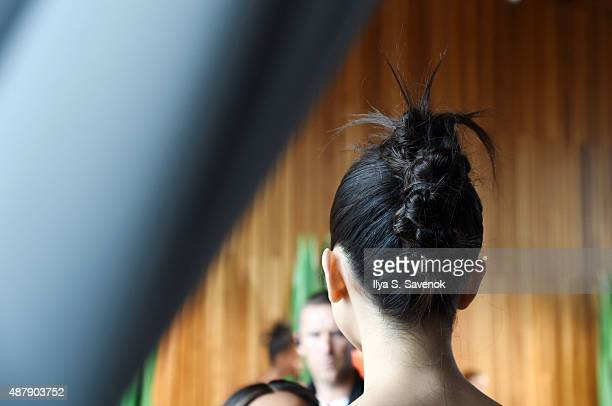 A model prepares backstage at the Isa Arfen Presentation during MADE Fashion Week Spring 2016 at The Standard Hotel on September 12 2015 in New York...