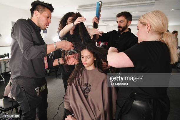 A model prepares backstage at the John Elliott fashion show during New York Week The Shows at Gallery II at Spring Studios on February 12 2018 in New...