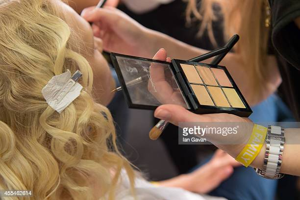 Model prepares backstage at the Jonathan Saunders show during London Fashion Week Spring Summer 2015 on September 14, 2014 in London, England.