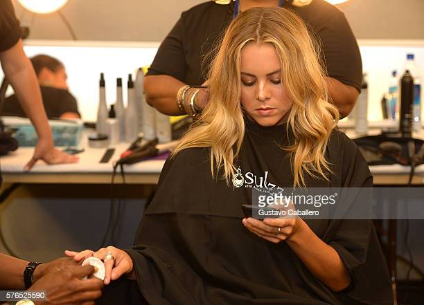 A model prepares backstage at the KAOHS 2017 Collection at SwimMiami at W South Beach on July 15 2016 in Miami Beach Florida