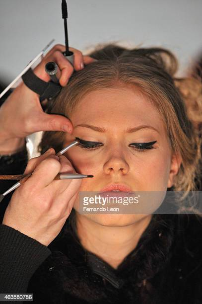 A model prepares backstage at the La Petite Robe fashion show during MercedesBenz Fashion Week Fall 2015 at The Pavilion at Lincoln Center on...