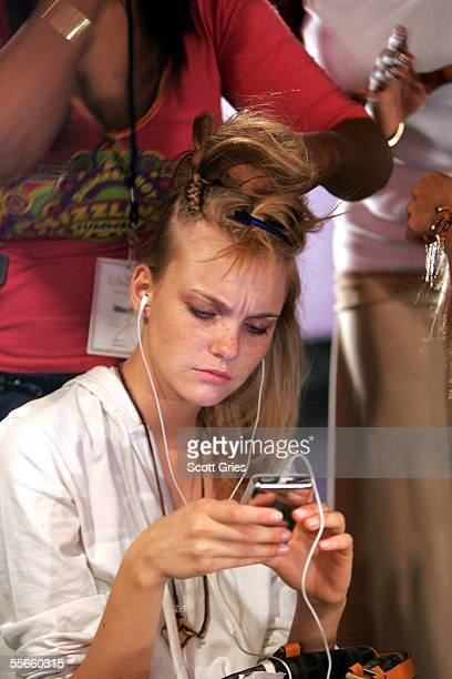 A model prepares backstage at the LAMB by Gwen Stefani Spring 2006 fashion show during Olympus Fashion Week at the Roseland Ballroom on September 16...