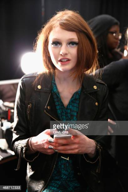 A model prepares backstage at the Libertine fashion show during MercedesBenz Fashion Week Fall 2014 at The Pavilion at Lincoln Center on February 11...