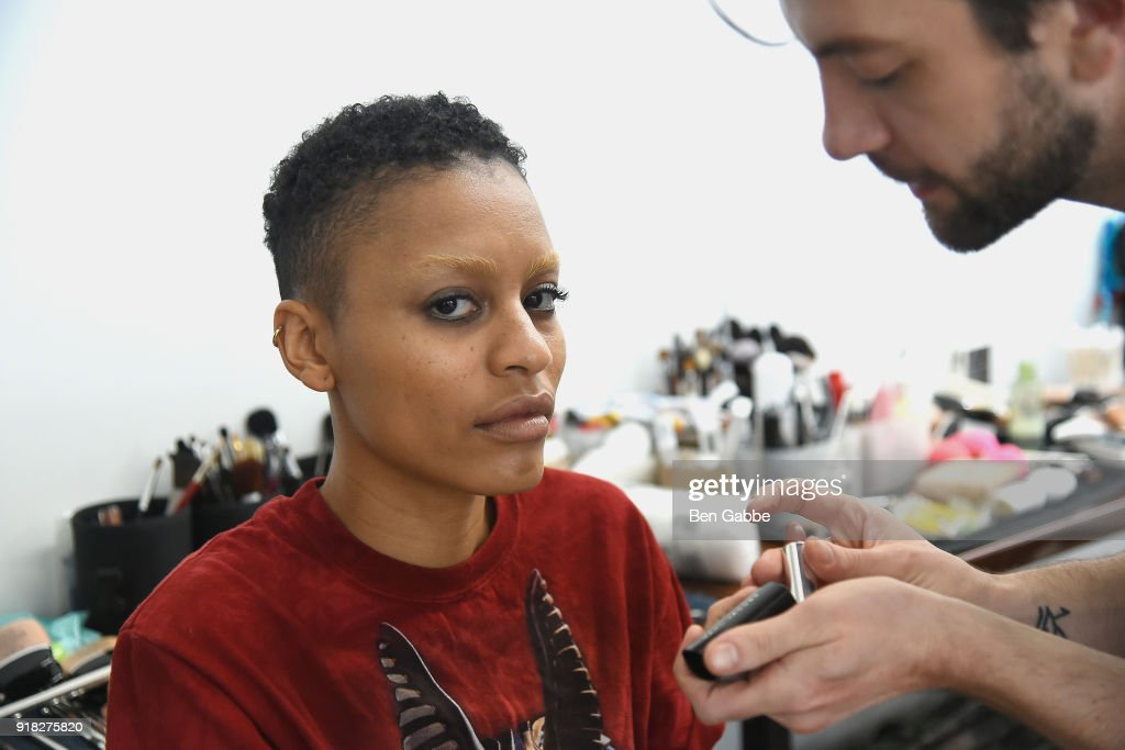 A model prepares backstage at the Maki Oh fashion show during New York Fashion Week on February 14, 2018 in New York City.