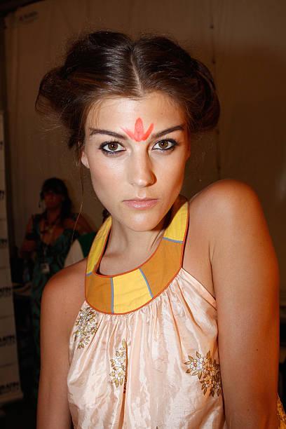 A Model Prepares Backstage At The Mara Hoffman Swim Show During Mercedes Benz Fashion Week