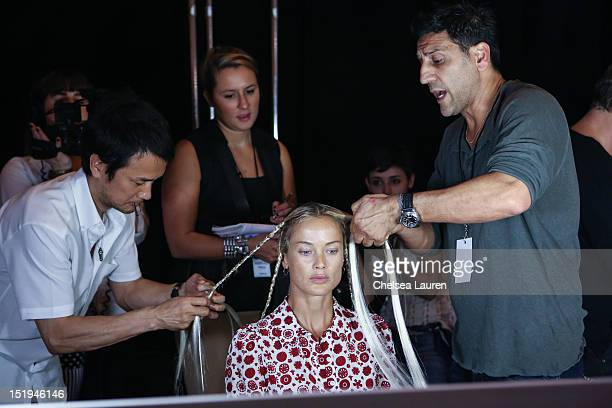 Model prepares backstage at the Marchesa spring 2013 fashion show during Mercedes-Benz Fashion Week at Vanderbilt Hall at Grand Central Terminal on...