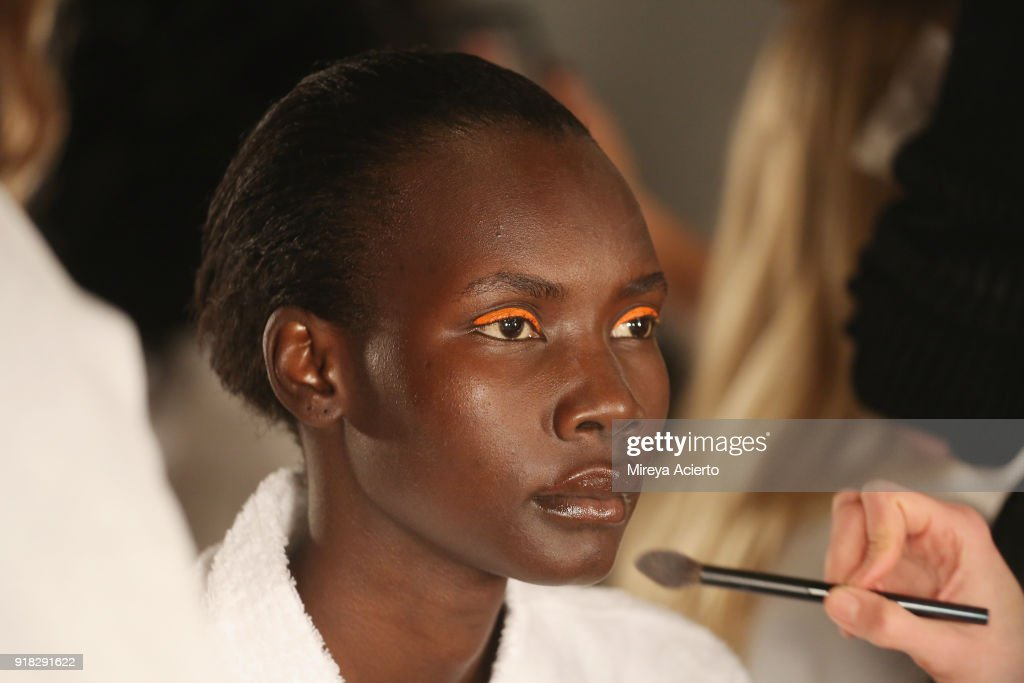 A model prepares backstage at the Maryam Nassir Zadeh fashion show during New York Fashion Week on February 14, 2018 in New York City.