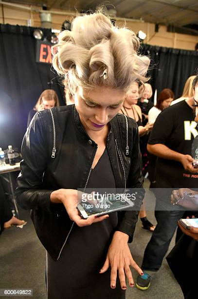 A model prepares backstage at the Michael Costello fashion show during New York Fashion Week The Shows September 2016 at The Dock Skylight at...