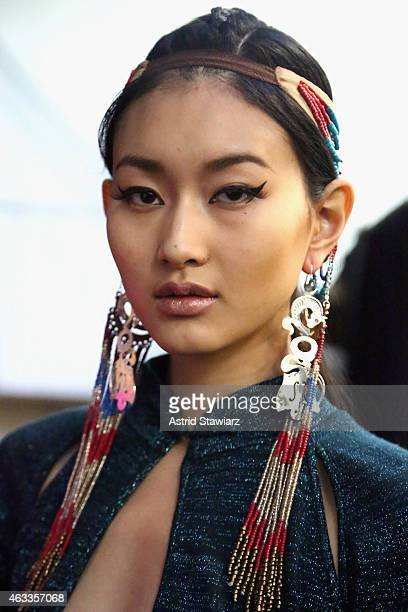 Model prepares backstage at the Mongol fashion show during Mercedes-Benz Fashion Week Fall 2015 at The Theatre at Lincoln Center on February 13, 2015...