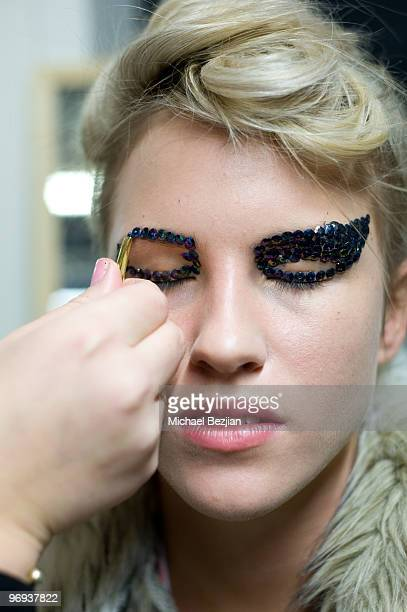 A model prepares backstage at the Moods of Norway Fall 2010 Collection at Oslo Fashion Week on February 21 2010 in Oslo Norway