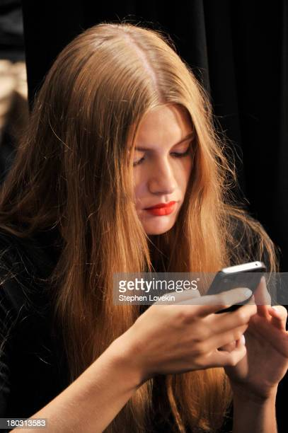 A model prepares backstage at the Nanette Lepore fashion show during MercedesBenz Fashion Week Spring 2014 at The Stage at Lincoln Center on...