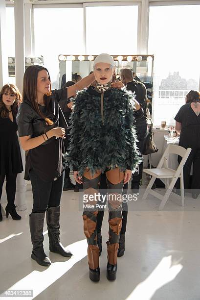 A model prepares backstage at the Nina Athanasiou fashion show during Mercedes Benz Fashion Week Fall 2015 at The Designer's Loft on February 13 2015...