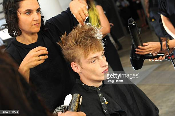 A model prepares backstage at the Patrik Ervell fashion show during MercedesBenz Fashion Week Spring 2015 at Milk Studios on September 8 2014 in New...