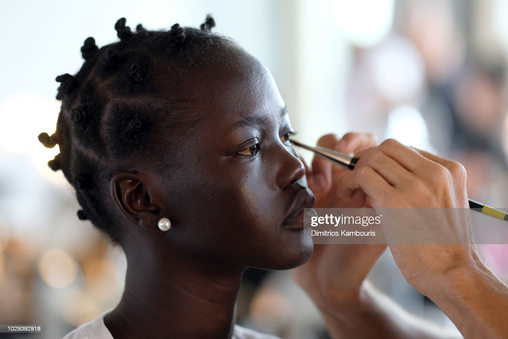 A model prepares backstage at the R13 Show during New York Fashion Week on September 8, 2018 in New York City.