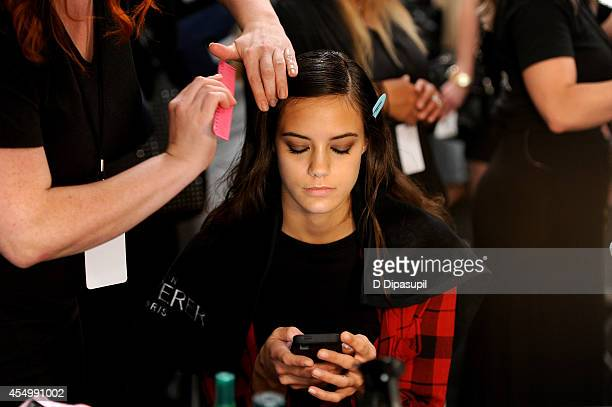 A model prepares backstage at the Reem Acra fashion show during MercedesBenz Fashion Week Spring 2015 at The Salon at Lincoln Center on September 8...
