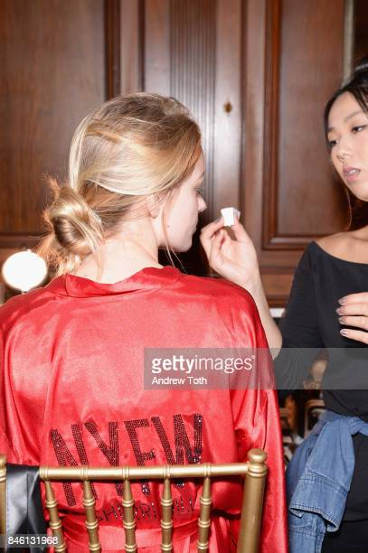 A model prepares backstage at the Sherri Hill NYFW SS18 fashion show at Gotham Hall on September 12 2017 in New York City