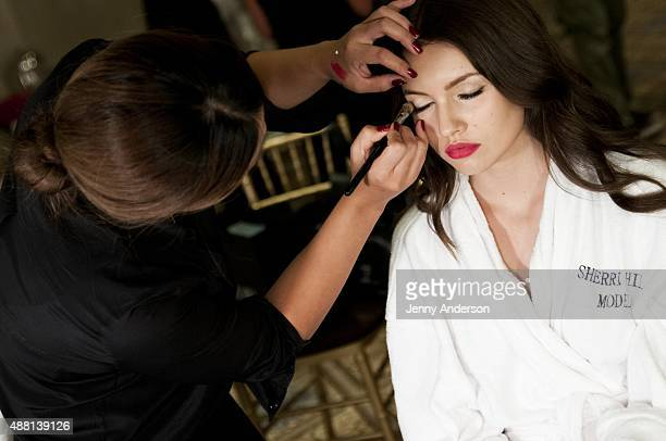 A model prepares backstage at the Sherri Hill Spring 2016 fashion show during New York Fashion Week at The Plaza Hotel on September 13 2015 in New...