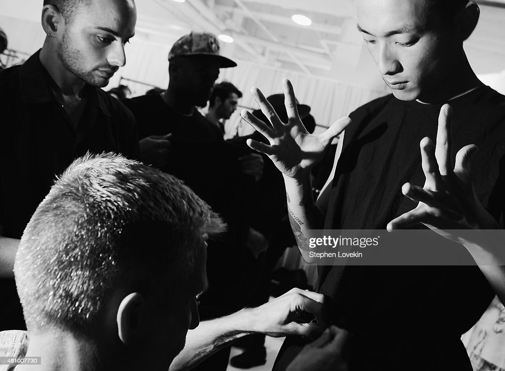 A model prepares backstage at the Siki Im fashion show during New York Fashion Week: Men's S/S 2016 at Skylight Clarkson Sq during New York Fashion Week: Men's S/S 2016 on July 16, 2015 in New York City.