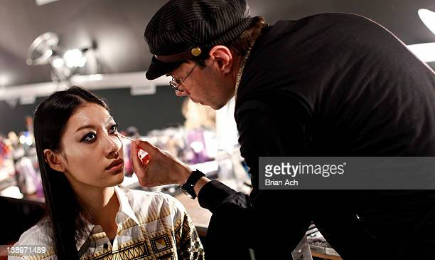 A model prepares backstage at the Sunhee fall 2012 fashion show during MercedesBenz Fashion Week at Exit Art on February 14 2012 in New York City