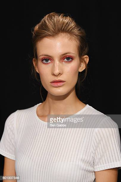 A model prepares backstage at the Tadashi Shoji fashion show during New York Fashion Week The Shows at The Arc Skylight at Moynihan Station on...