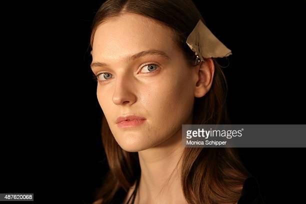 A model prepares backstage at the Tadashi Shoji fashion show during Spring 2016 New York Fashion Week at The Dock Skylight at Moynihan Station on...
