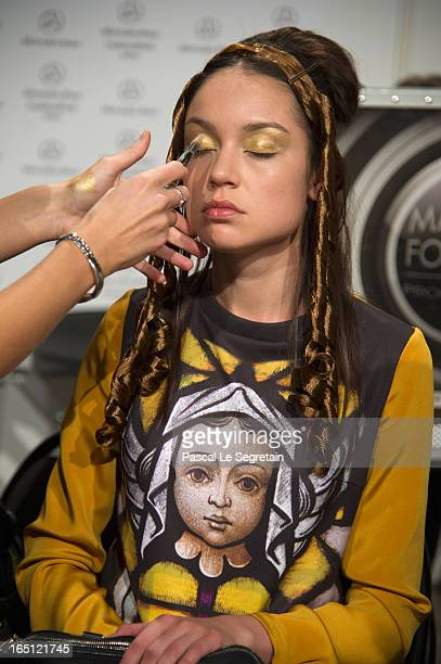 A model prepares backstage at the Tatyana Parfionova show during MercedesBenz Fashion Week Russia Fall/Winter 2013/2014 at Manege on March 31 2013 in...