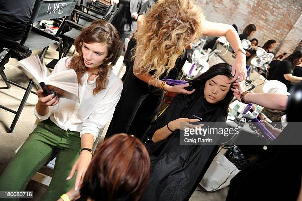 A model prepares backstage at the Thakoon fashion show during MercedesBenz Fashion Week Spring 2014 at Dia Art Foundation on September 8 2013 in New...