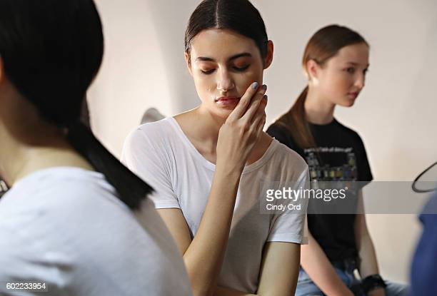 A model prepares backstage at the Tibi fashion show during New York Fashion Week at Industria Studios on September 10 2016 in New York City